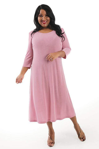 a dark haired, brown skinned woman wearing a pink a line maxi dress