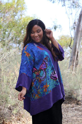 Allegra in a blue and purple butterfly print kimono jacket