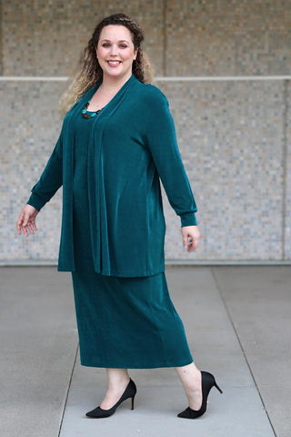 a smiling woman wearing a Vikki Vi Deep Teal outfit