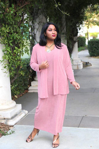 brown skinned woman with long straight black hair wearing a pink outfit