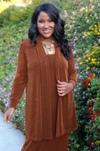 a brown skinned, dark haired woman smiling at the camera and wearing Rust Vikki Vi Classics