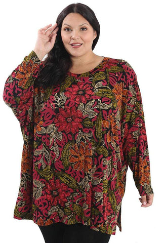 a dark haired woman wearing a red and orange floral print swing top