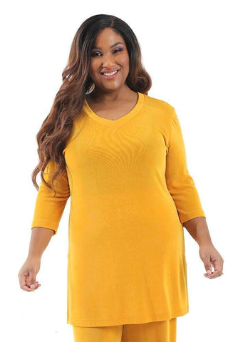 Allegra in a yellow tunic