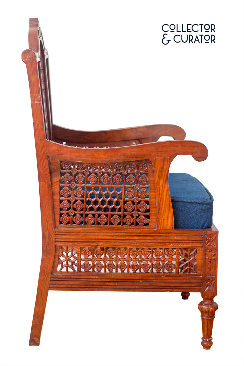 Exotic Carved wooden chair with denim seat cushion - Collector & Curator