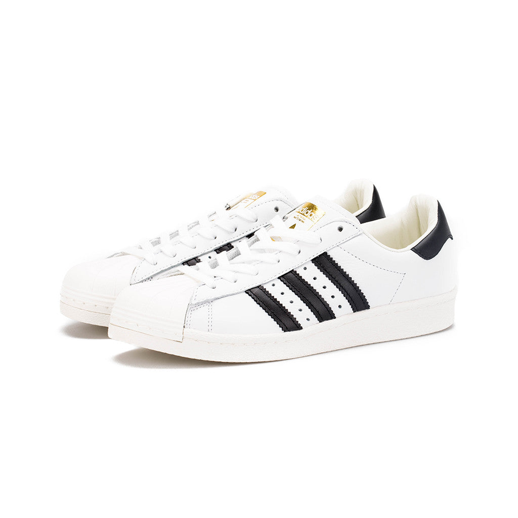 classic fit a0910 17c4a adidas Originals - Superstar Boost™ (Running White Core Black Gold Met –  amongst few