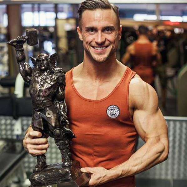 Becoming World Champion In #MuscleMutt Burnt Orange Vest