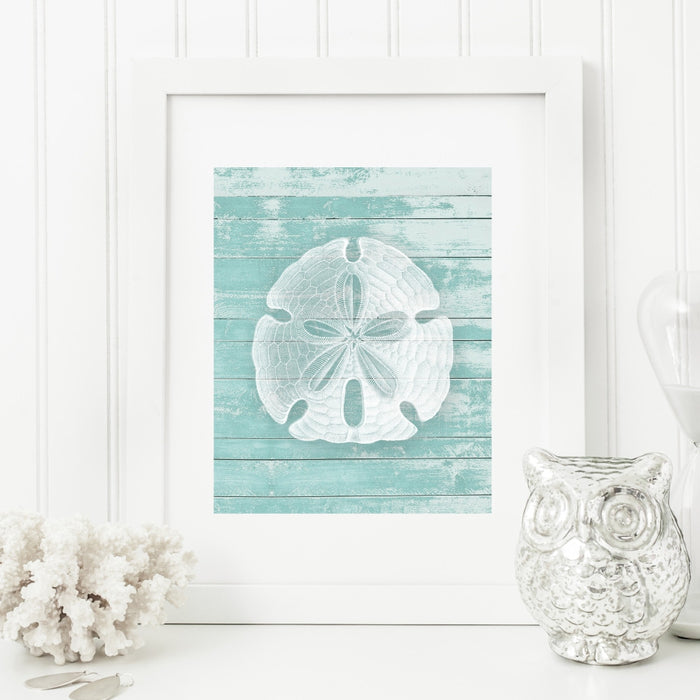 Sand Dollar Wall Art in Teal on a Faux Wood Background