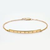 Skinny gold bar bracelet personalized with 'Forever'