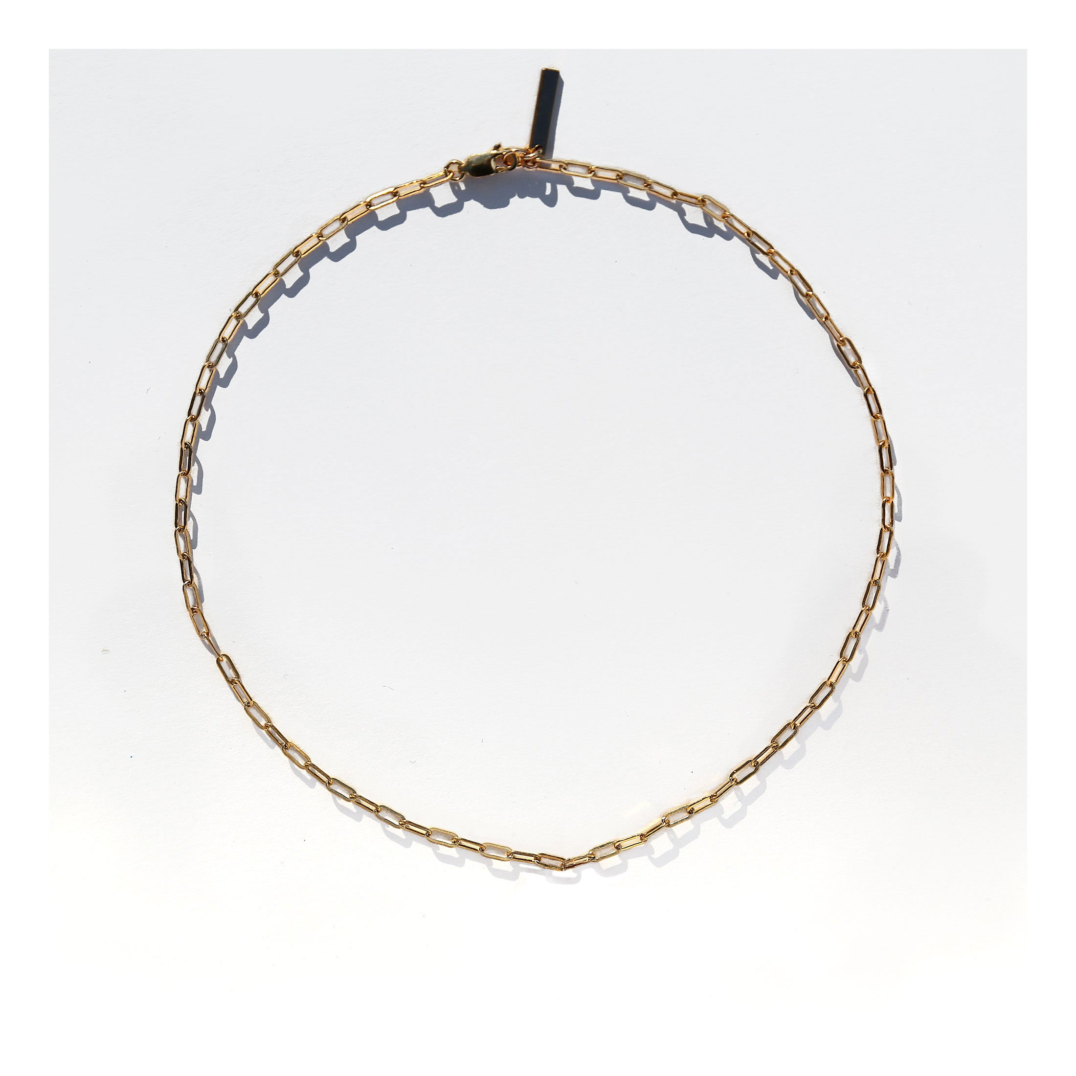 Link chain necklace made of 14k gold filled metal, with adjustable chain.