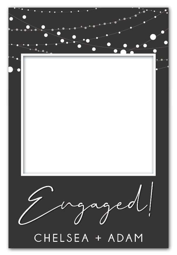 lights-on-charcoal-engagement-party-photo-booth-frame