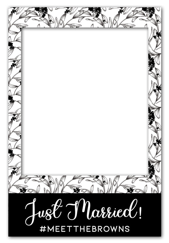 elegant-black-and-white-flowers-photo-booth-frame-prop