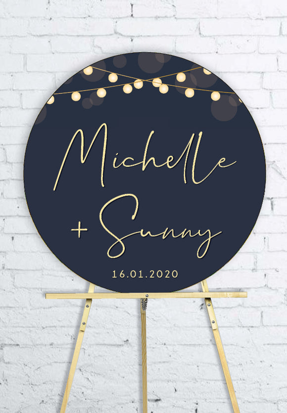 round-lights-on-blue-engagement-party-welcome-sign