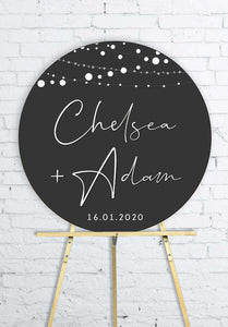 round-lights-on-charcoal-engagement-party-welcome-sign