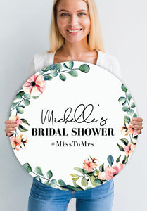 customer-with-round-eucalyptus-floral-bridal-shower-welcome-sign