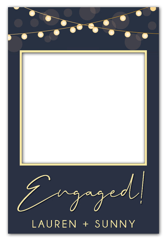 lights-on-blue-engagement-party-photo-booth-frame