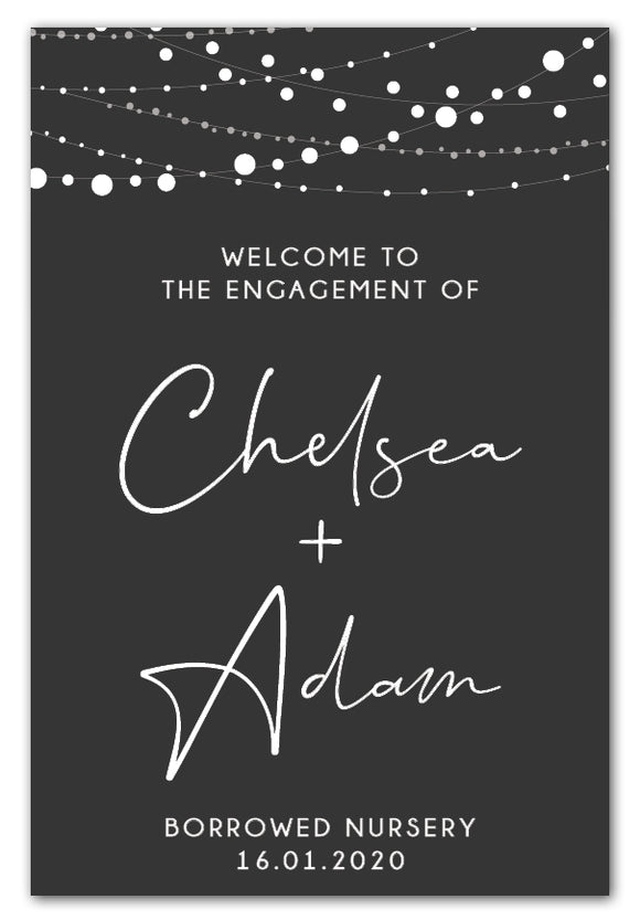 lights-on-charcoal-engagement-party-welcome-sign