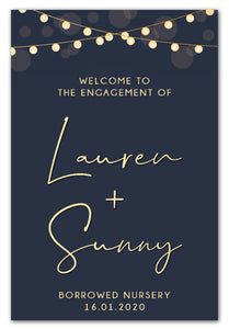 lights-on-blue-engagement-party-welcome-sign