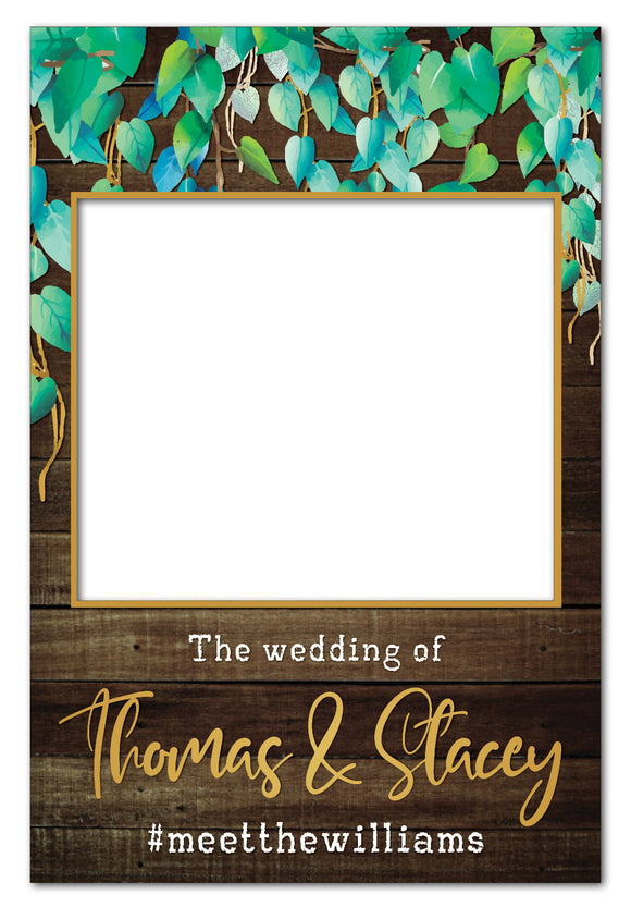 wild-leaves-and-dark-wood-rustic-wedding-photo-booth-frame
