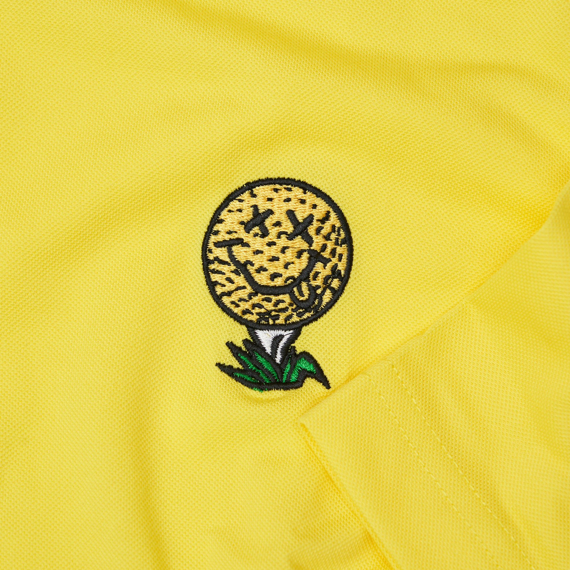golf-ball-tee-polo-shirt-yellow-birds-of-condor-sport