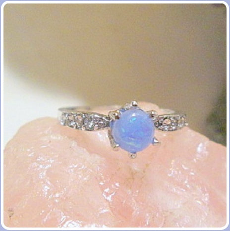 Luck Drawing Blue Fire Opal Sterling Silver Ring