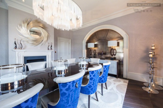 Luxury dining space with bright blue seating, chandelier and lacquered table - design practice by uber