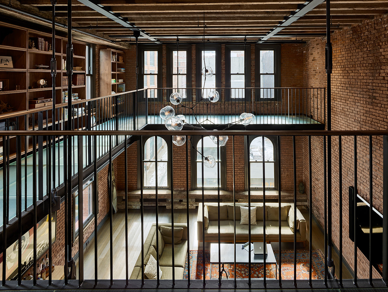 galleried library 10 Hubert Street exposed red brick with iron railings