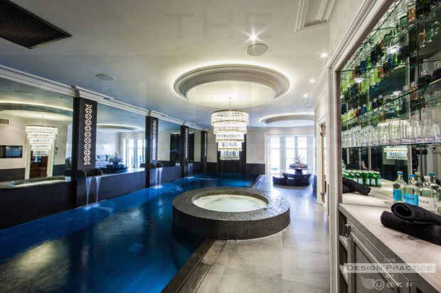 Luxury home indoor swimming pool with chandelier - design practice by uber