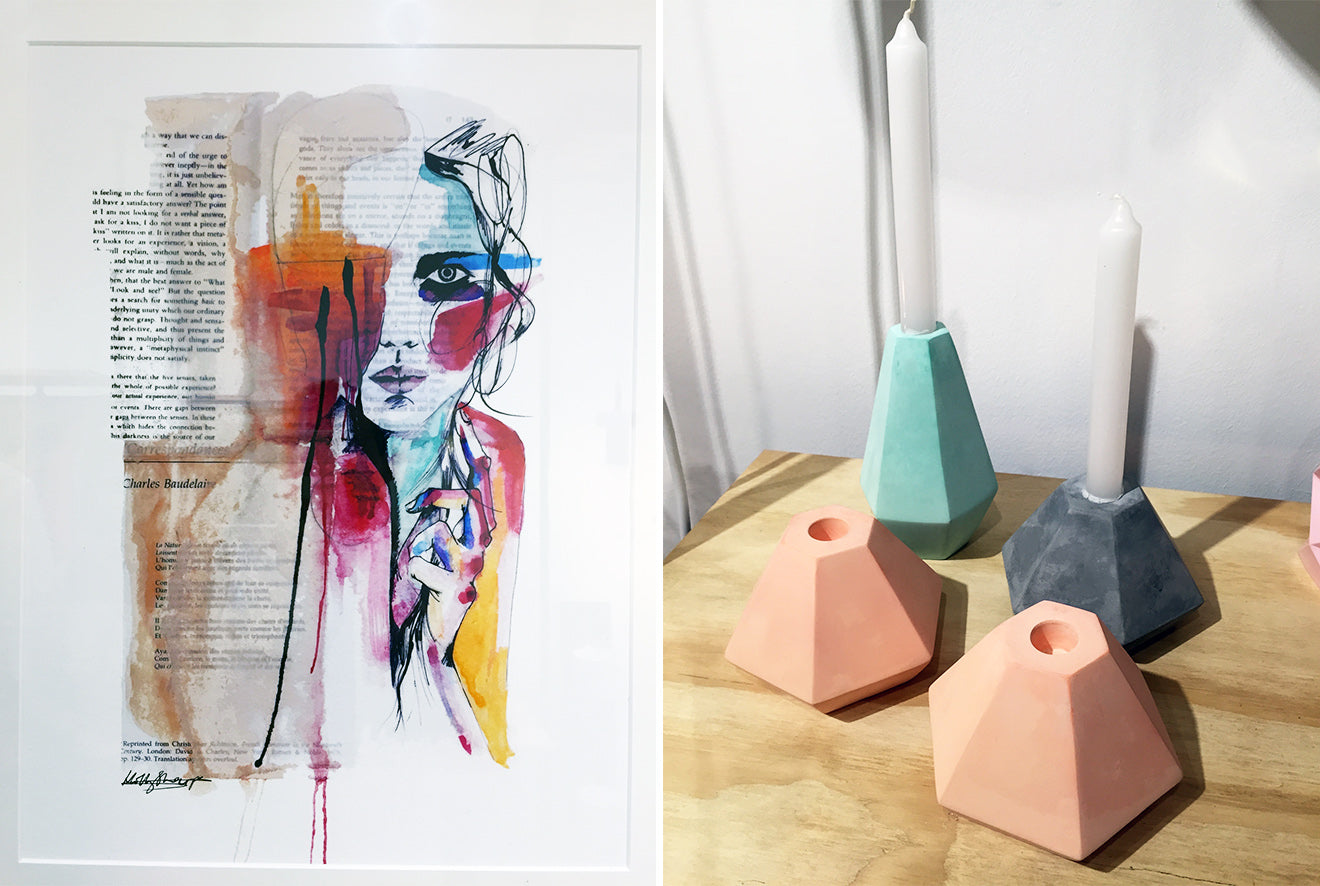 Newspaper artwork with colour and concrete modern candle holders in pastel colours