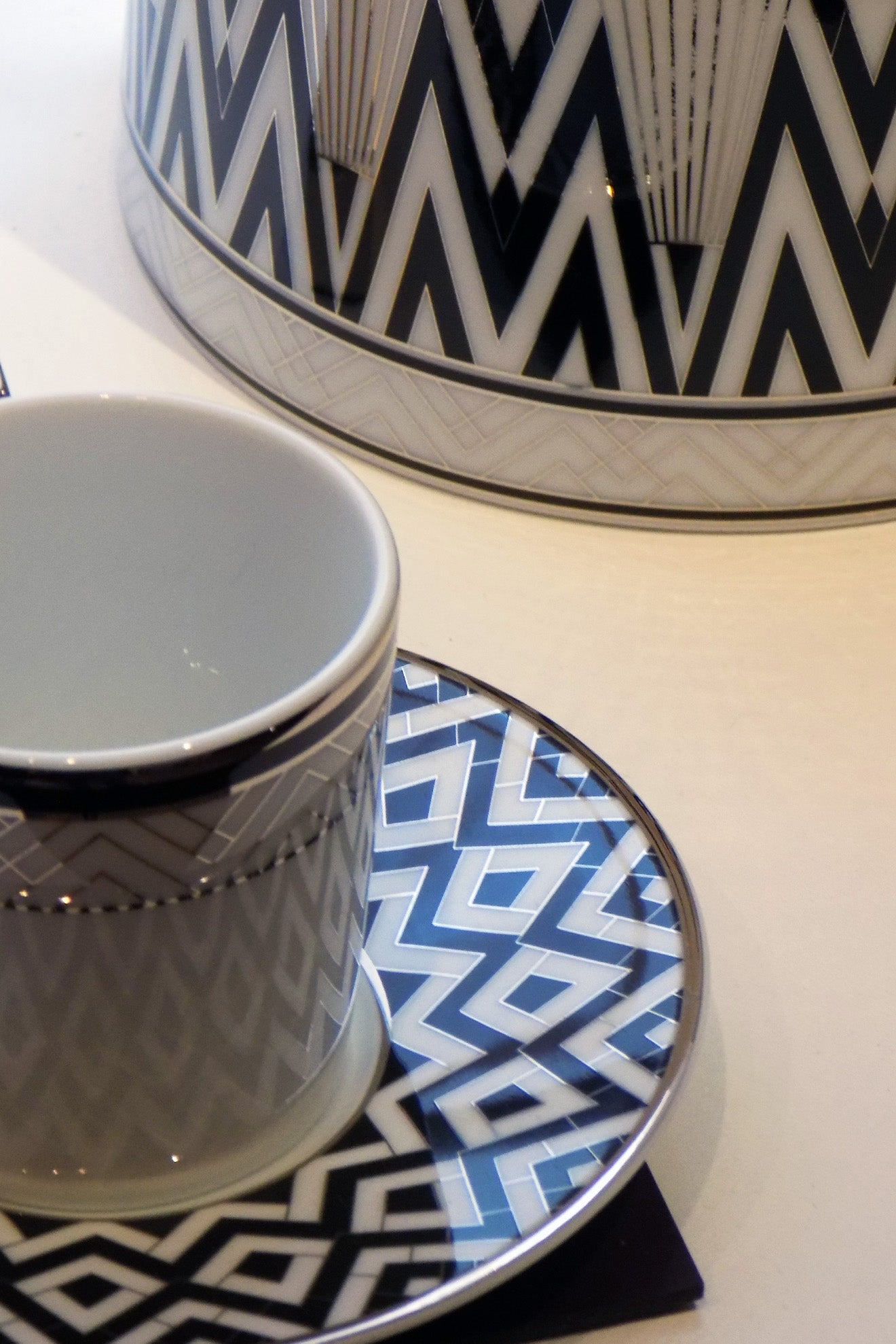 Art Deco styled teaware with black, white and silver detailing