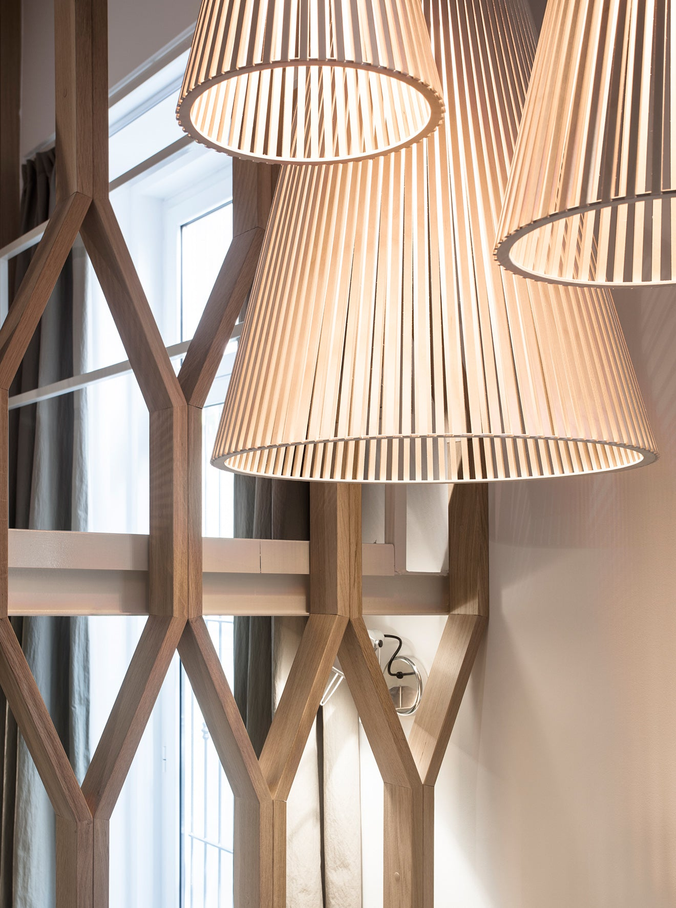 Luxury light fittings against wooden geometric screen