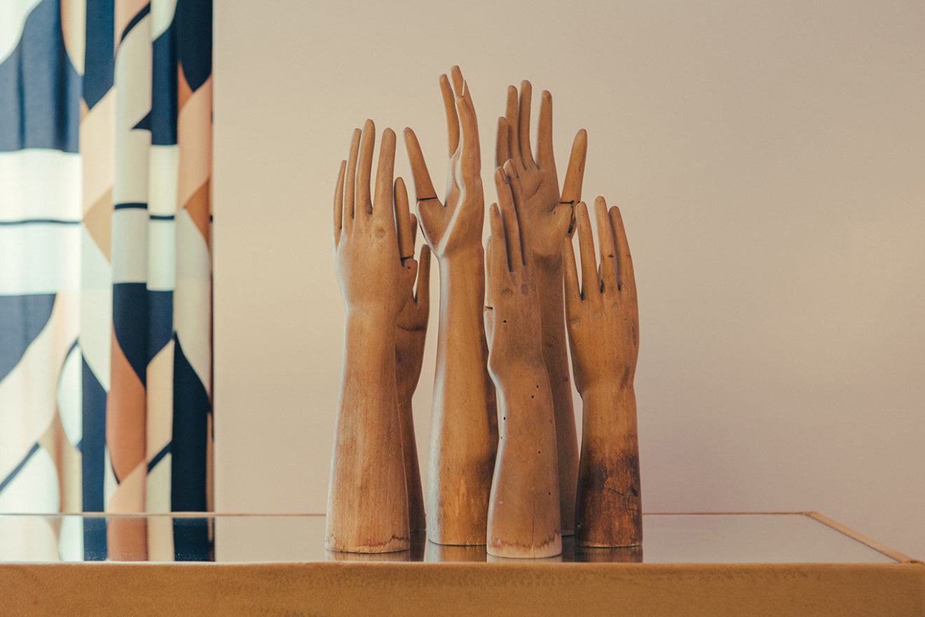 Wooden hand sculptures on the sideboard at Hotel Saint Marc