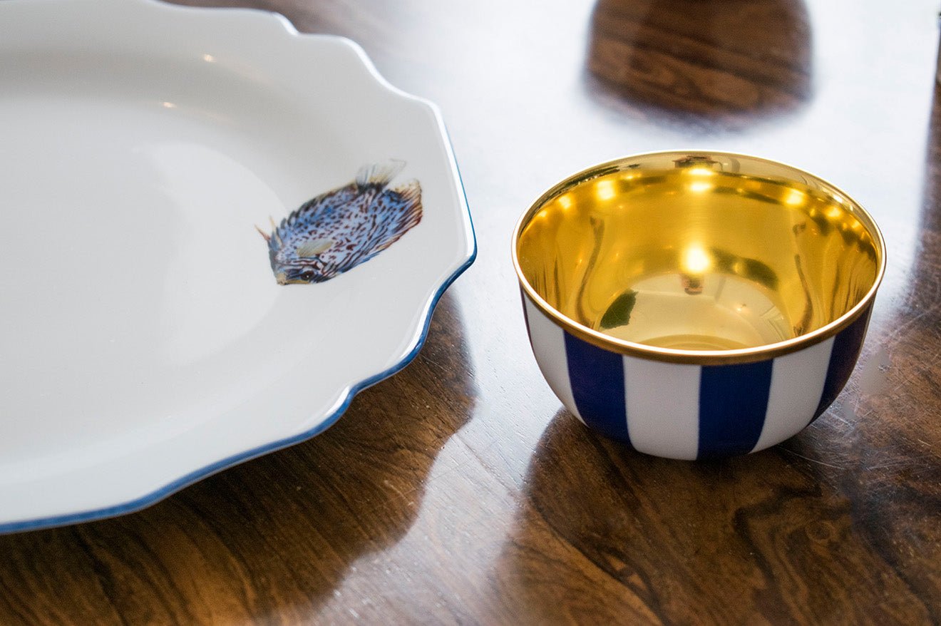 Asprey Fish Crockery with gold plated champagne coupe