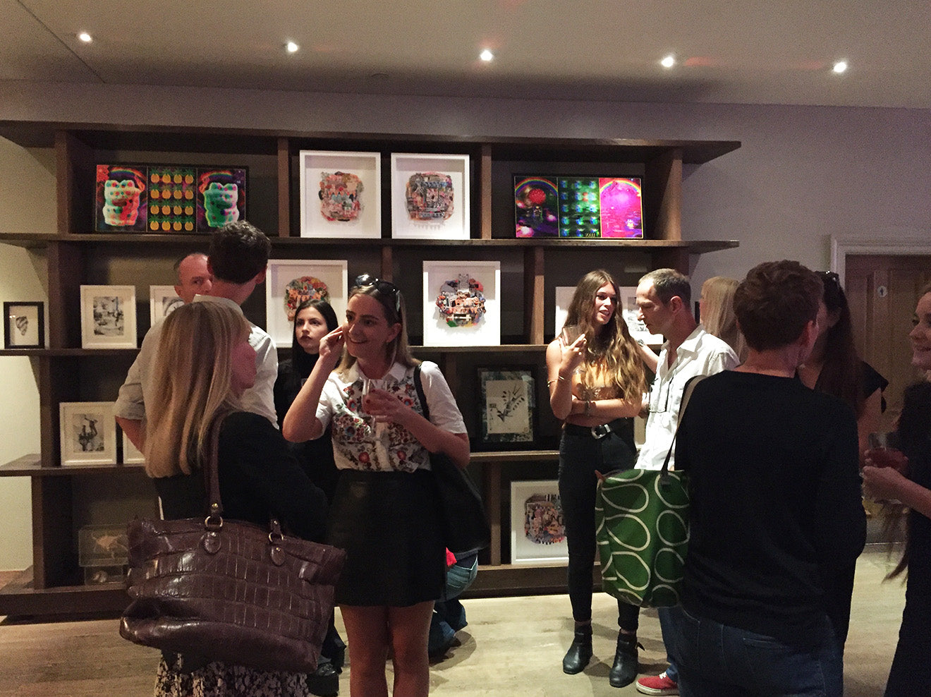Assemblage at Firmdale guests viewing artwork on display