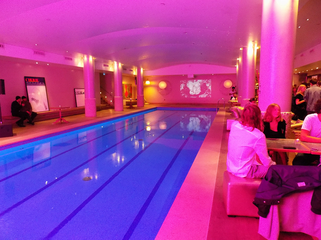 Swimming pool surrounded by artwork at the Haymarket Hotel London