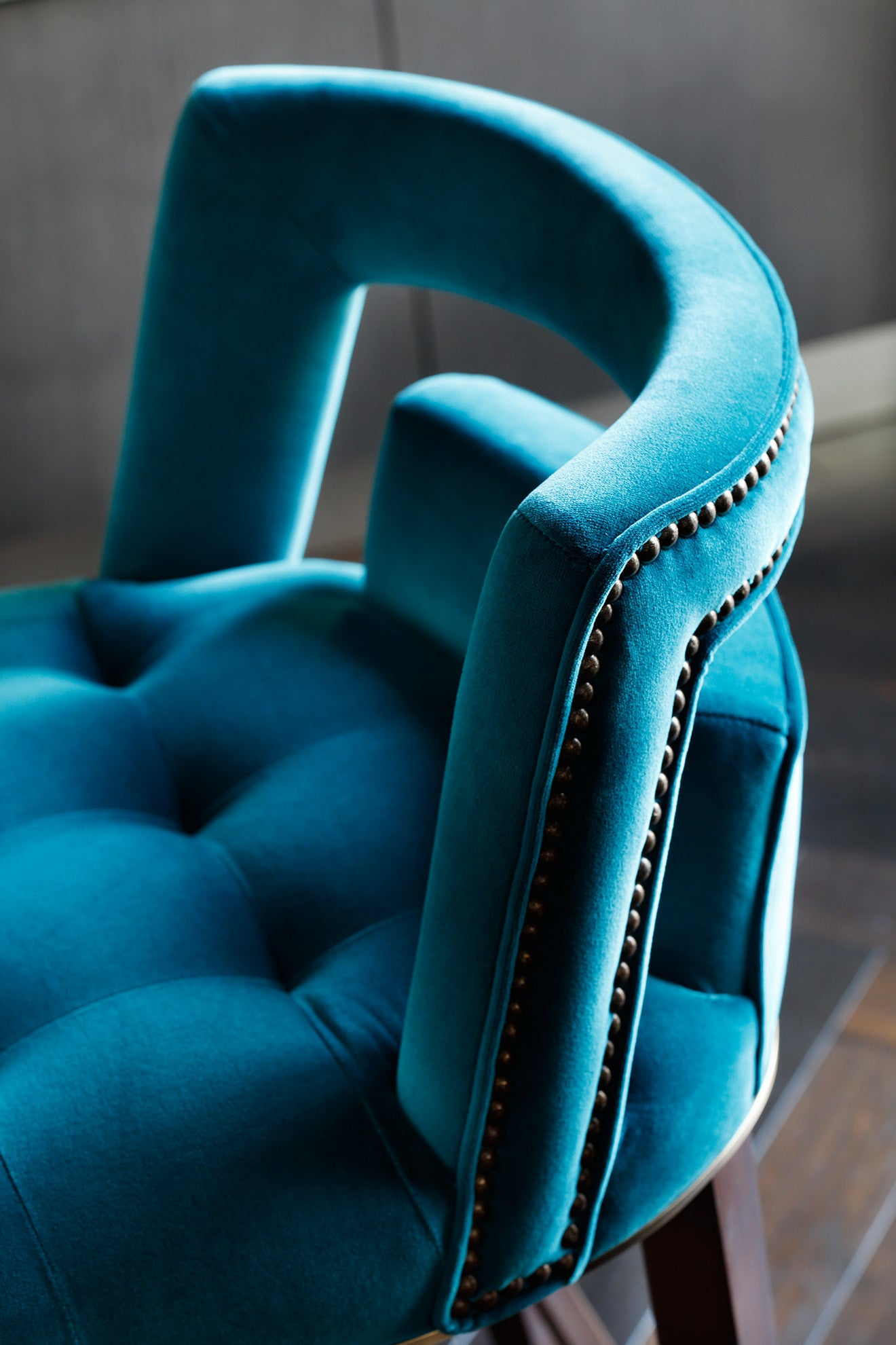 vibrant blue upholstered kitchen stool by Brabbu design by Oliver Burns Beau House Penthouse