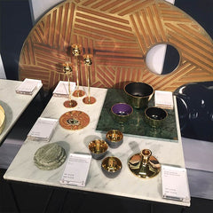 Brass and marble candle holders, plates and bowls at Designjunction London Design Festivlal