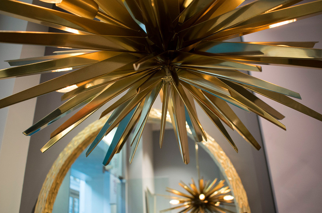 Spikey brass pendant light at Marc De Berny