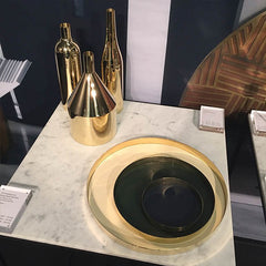 Brass gold circular trays and vases design junction London Design Festival