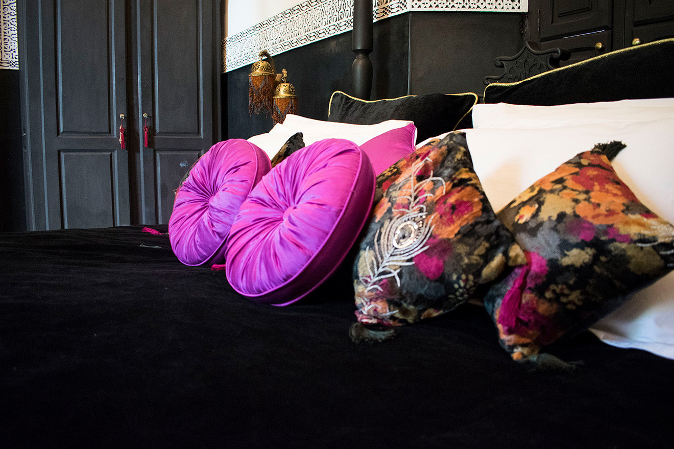pink velvet and floral cushions in the State of Grace Suite