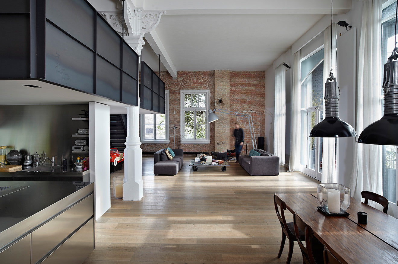 Large warehouse apartment with industrial interior design and exposed red brickwork
