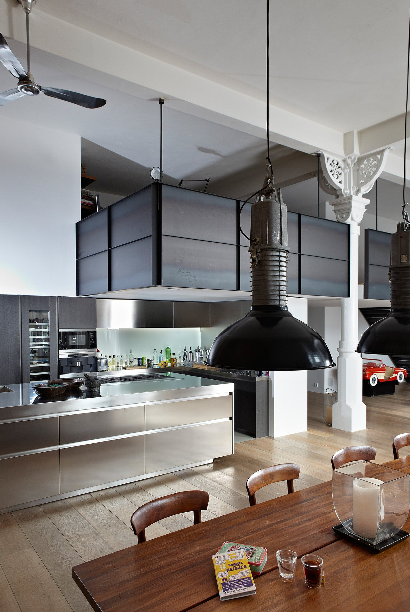 open plan stainless steel kitchen with industrial style suspended mezzanine floor