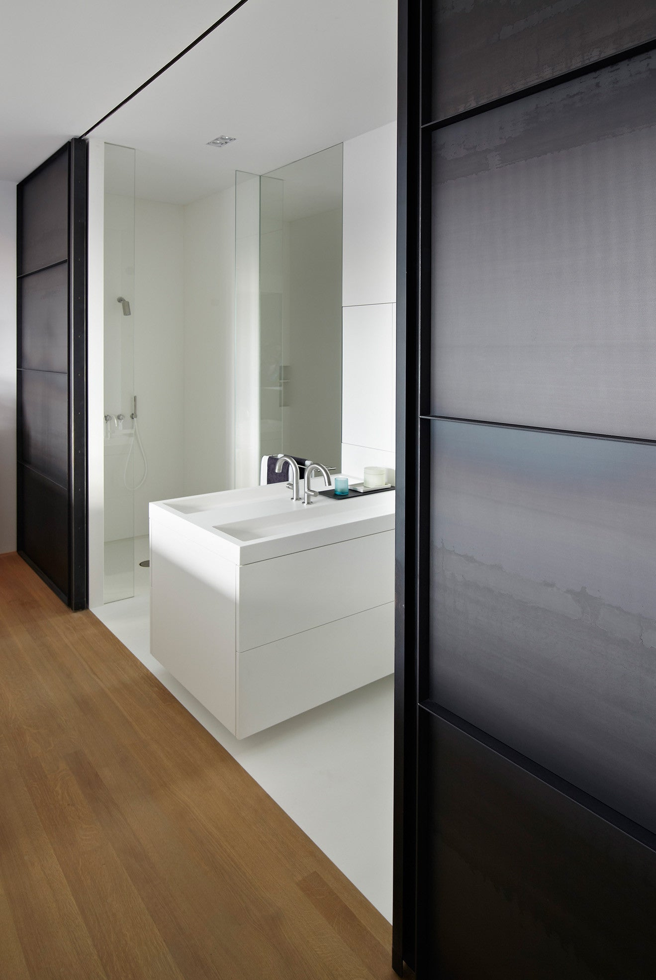 Large industrial doors slide back to reveal the shower and washroom