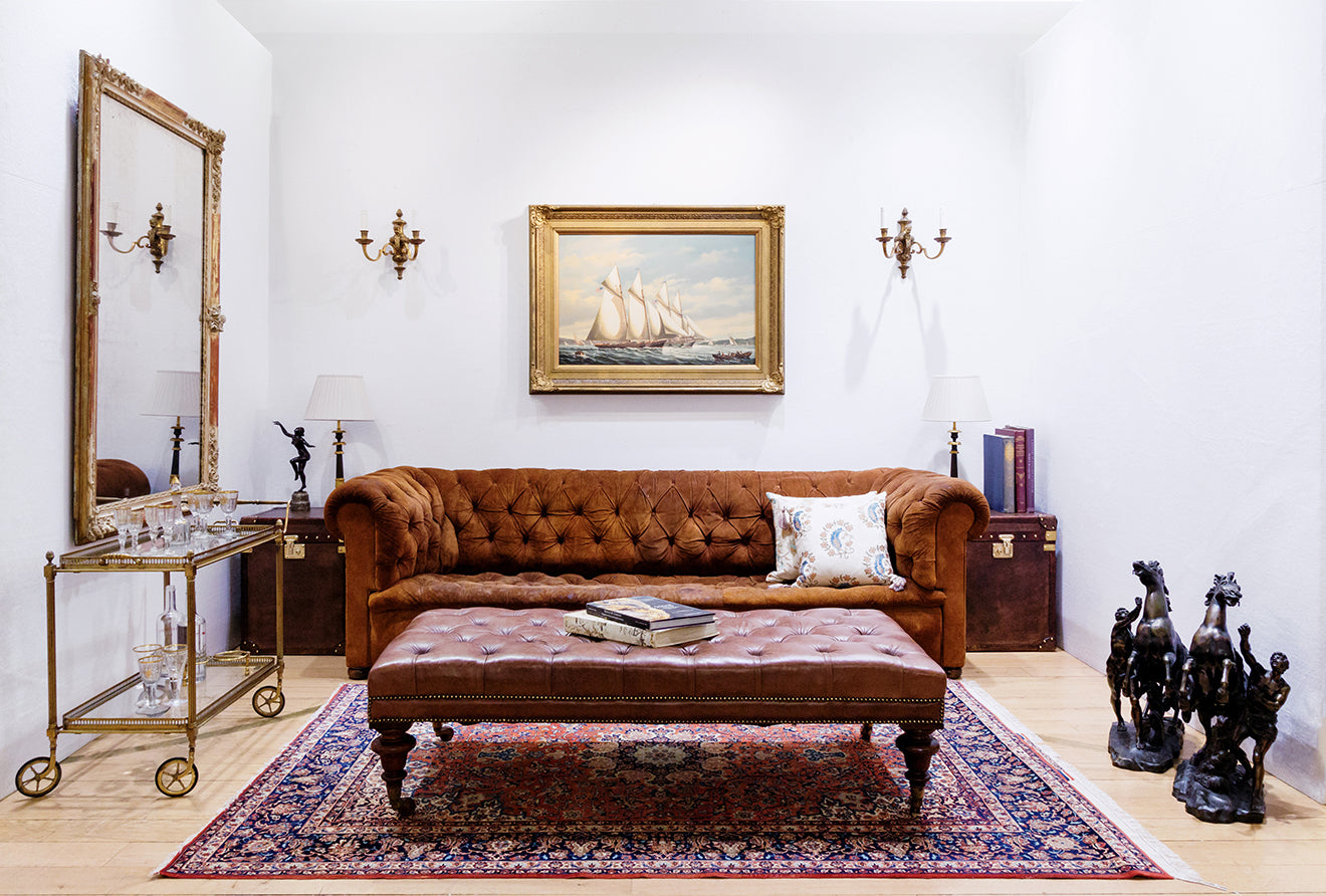 Drawing room inspiration with chesterfield sofa and antiques