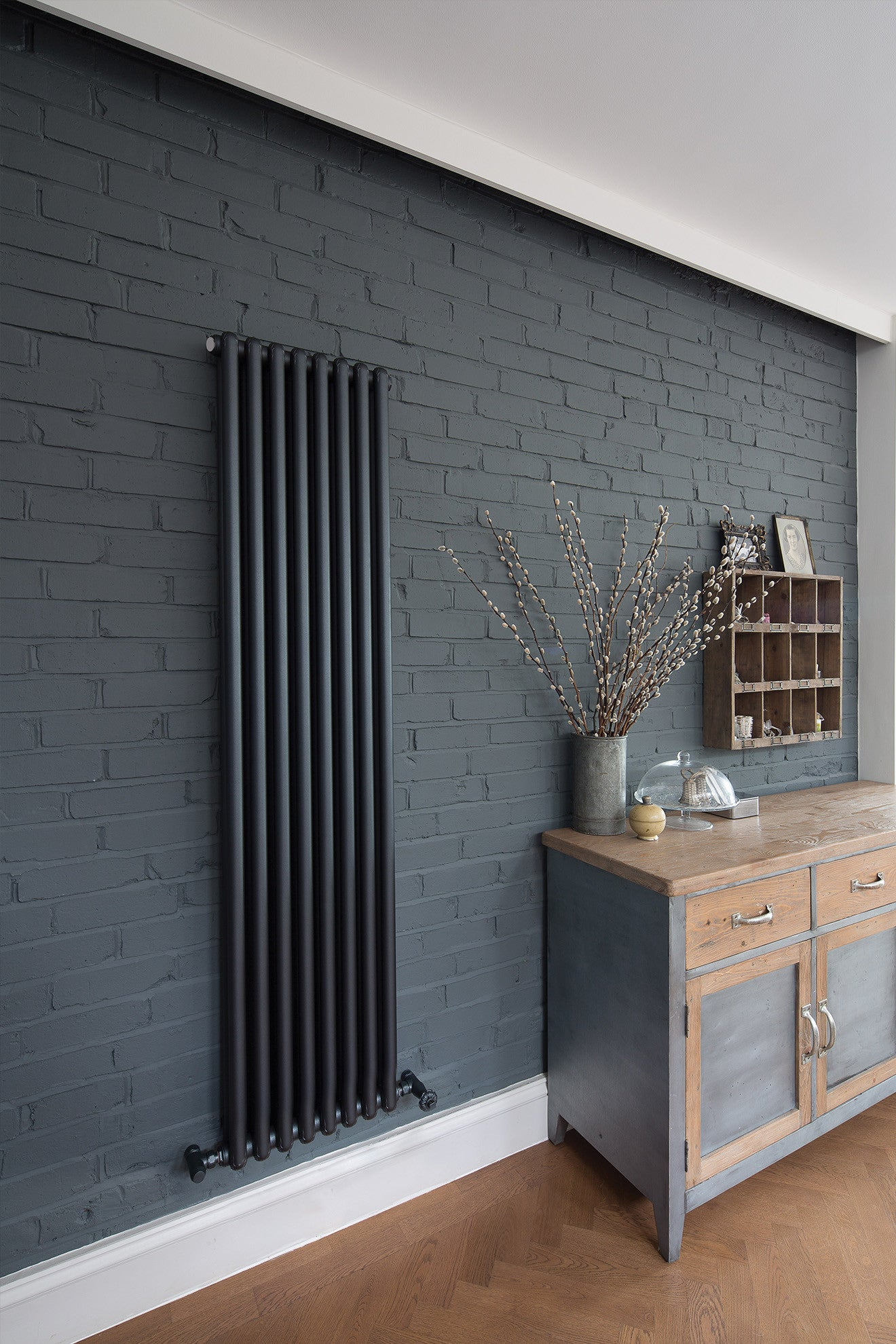 Black industrial tall radiator by Bisque radiators