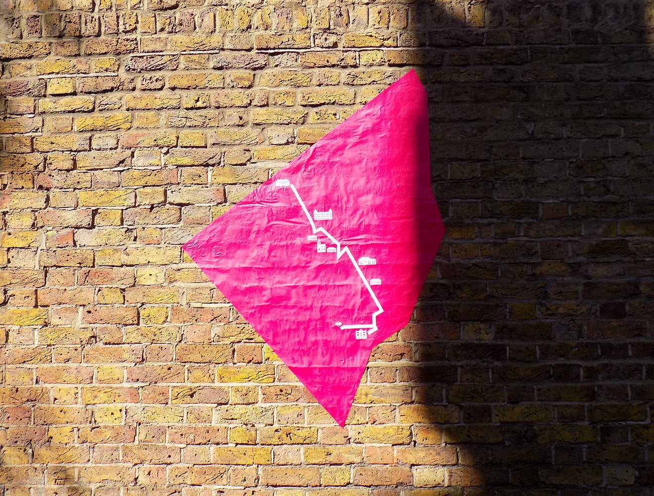 Clerkenwell Design Week pink map on wall