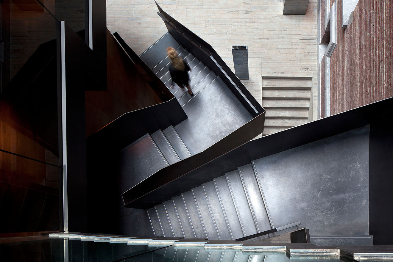 huge metal industrial staircase at the Conservatorium hotel Museumplein Amsterdam