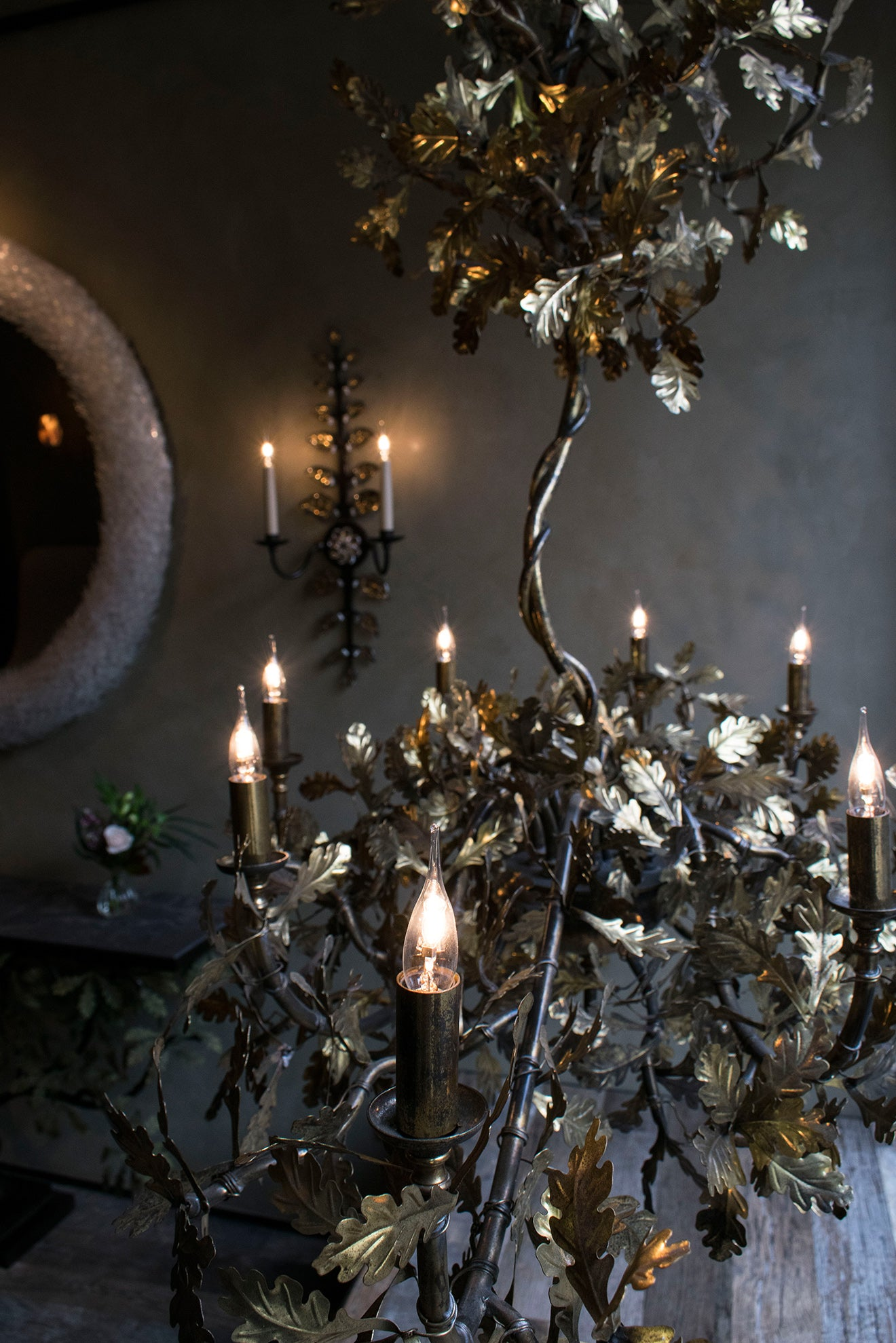 Cox London gold oak leaf chandelier on display in the shop window
