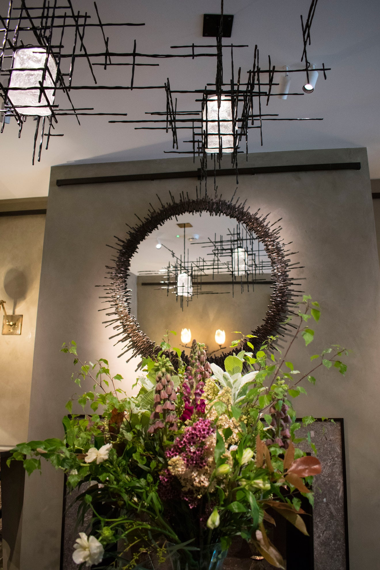 Cox London metal circular mirror and modern chandelier