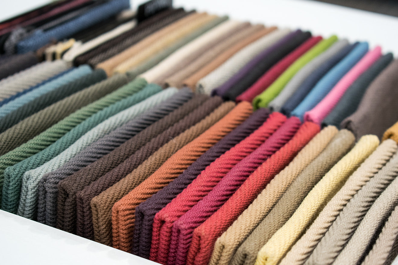 Crucial Trading showroom Creating a Bespoke Rug Design Colourful Fabric Swatches