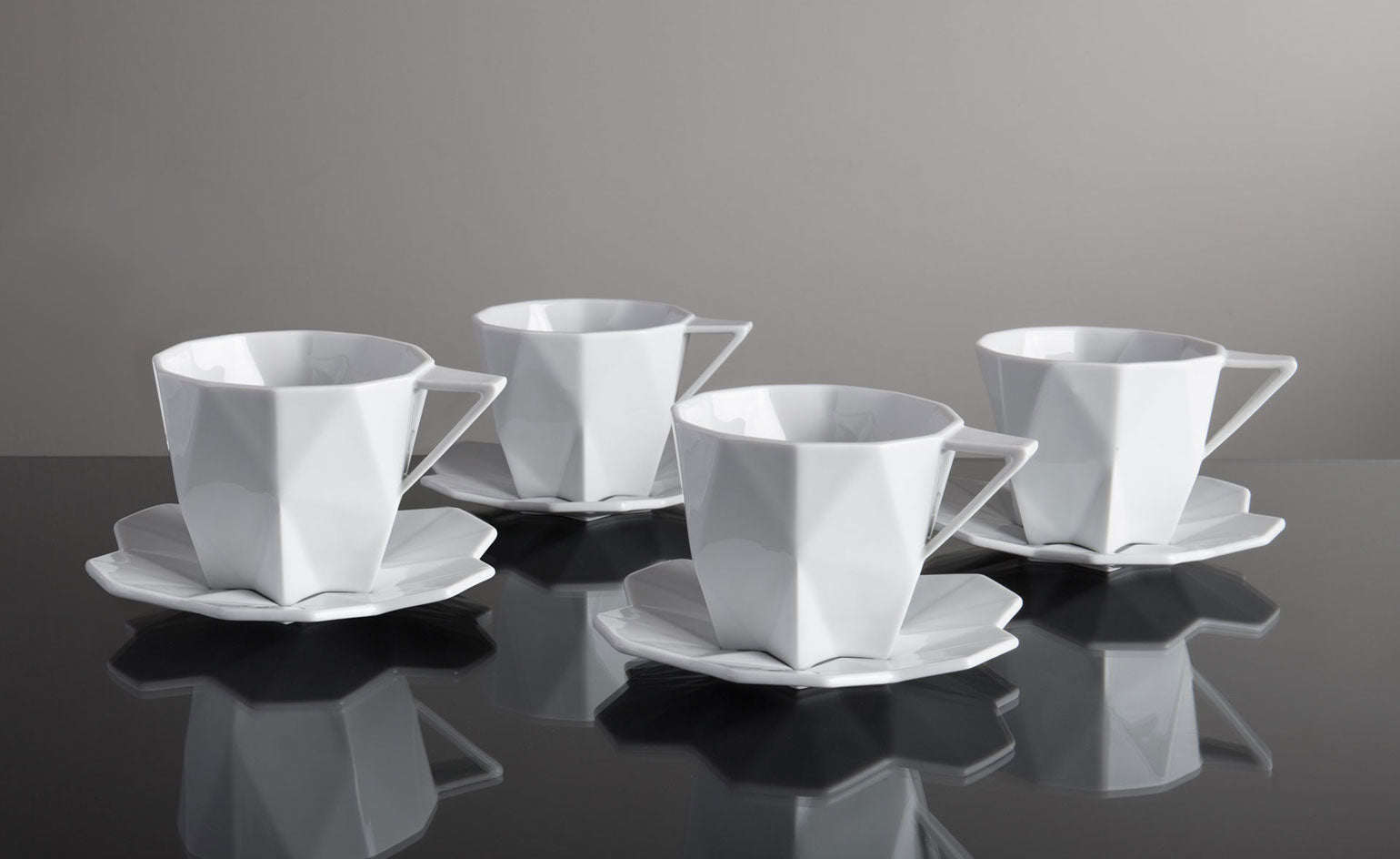 White cubist teacups and saucers from Lauriger
